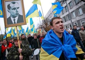 Svoboda members in Kiev celebrating Ukrainian WWII Nazi collaborators (portrait of Stepan Bandera, Ukrainian WWII fascist leader, at front).